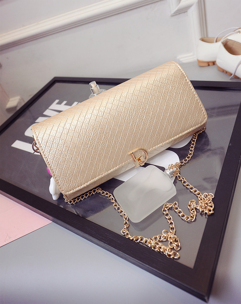 B433 IDR.180.000 MATERIAL PU SIZE L28XH16XW3CM WEIGHT 600GR COLOR GOLD.jpg